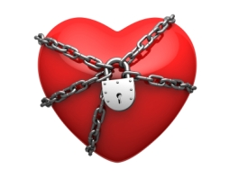 Red heart wound around chain and locked on lock. There is a clipping path